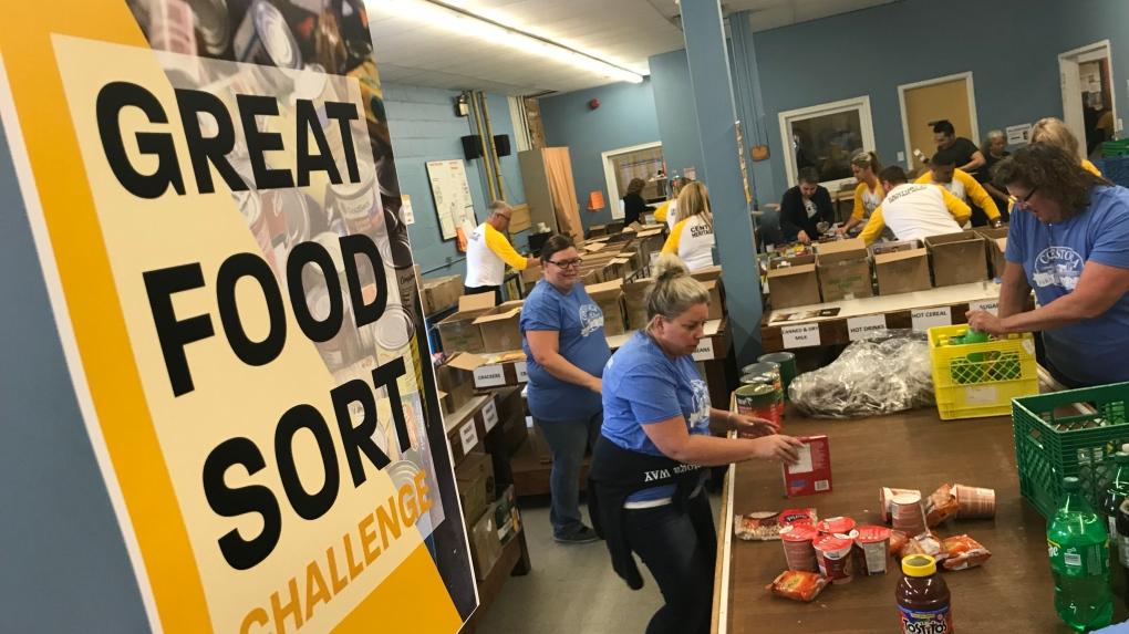 Teams sort food into boxes