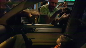 "Eliane Jabbour's 15-month-old son was scared when protesters surrounded their car in Lebanon. So the protesters started singing ""Baby Shark"" to calm him. (Courtesy Eliane Jabbour)"