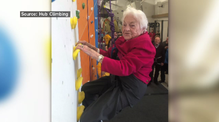 Hazel McCallion climbing a rock wall