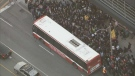 Commuters are seen waiting for shuttle buses after a partial closure of Line 1 on Oct. 22. (CTV News Toronto)