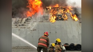 Firefighters fight a workshop fire
