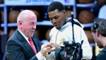Toronto Raptors guard Kyle Lowry receives his 2019 NBA championship ring from Larry Tanenbaum, chairman of Maple Leaf Sports & Entertainment, before playing the New Orleans Pelicans in Toronto on Tuesday Oct. 22, 2019. THE CANADIAN PRESS/Frank Gunn