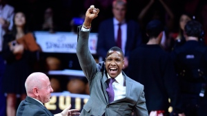 The Toronto Raptors president Masai Ujiri receives his 2019 NBA championship ring from Larry Tanenbaum, chairman of Maple Leaf Sports & Entertainment, before playing the New Orleans Pelicans in Toronto on Tuesday Oct. 22, 2019. (THE CANADIAN PRESS/Frank Gunn)