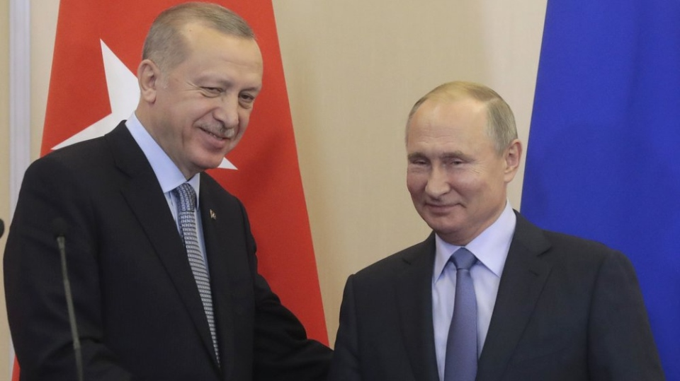 Russian President Vladimir Putin, right, and Turkish President Recep Tayyip Erdogan shake hands after their joint news conference following their talks in the Bocharov Ruchei residence in the Black Sea resort of Sochi, Russia, Tuesday, Oct. 22, 2019. (Sergei Chirikov/Pool Photo via AP)