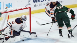 Minnesota Wild's Eric Staal (12) scores against Edmonton Oilers goalie Mike Smith (41) during the first period of an NHL hockey game Tuesday, Oct. 22, 2019, in St. Paul, Minn. (AP Photo/Stacy Bengs)