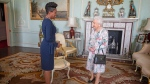 Queen Elizabeth II receives the High Commissioner for Grenada, Lakisha Grant, during a private audience at Buckingham Palace, London. PA Photo. Picture date: Tuesday Oct, 22, 2019. (Victoria Jones/PA via AP)