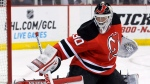 New Jersey Devils goaltender Martin Brodeur deflects the puck during the first period of an NHL hockey game against the Chicago Blackhawks in Newark, N.J., on January 3, 2014. THE CANADIAN PRESS/AP, Bill Kostroun