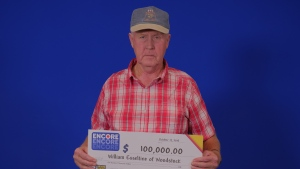 William Esselstine, of Woodstock, holds a cheque for $100,000. (Source: OLG)