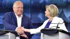 Ontario Progressive Conservative Leader Doug Ford, left, and Ontario NDP Leader Andrea Horwath shake hands at the end of the third and final televised debate of the provincial election campaign in Toronto, Sunday, May 27, 2018. THE CANADIAN PRESS/Frank Gunn