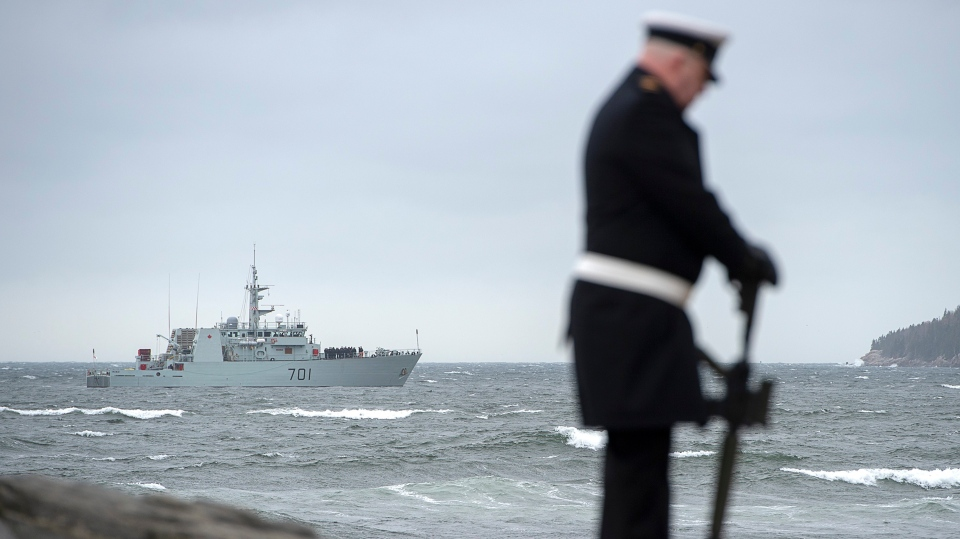 HMCS Glace Bay, a Kingston-class coastal defence vessel, cruises near the shore as friends, family and military personnel attend the 50th anniversary of the fire and explosion in HMCS Kootenay at the Bonaventure Anchor Memorial in Point Pleasant Park in Halifax on Wednesday, Oct. 23, 2019.  (THE CANADIAN PRESS/Andrew Vaughan)