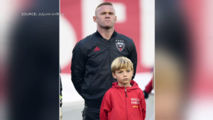 Wayne Rooney, rear, stands with Erik Bettridge at the TFC game on Saturday. (Photo by Julian Avram)