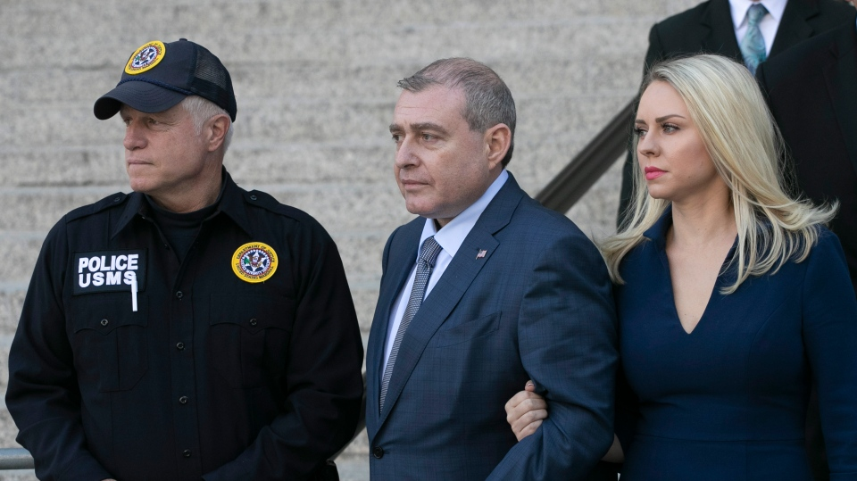 Lev Parnas, centre, leaves federal court following his arraignment, Wednesday, Oct. 23, 2019 in New York. (AP Photo/Mark Lennihan)