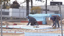 Workers at the site of a proposed condo developmen