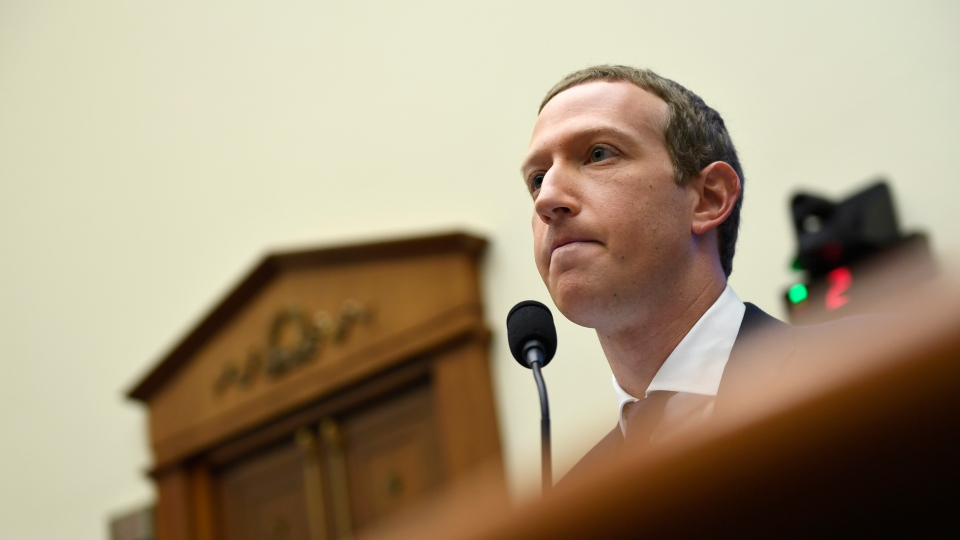 Facebook Chief Executive Officer Mark Zuckerberg testifies before the House Financial Services Committee on Capitol Hill in Washington, Wednesday, Oct. 23, 2019, to discuss his plans for the new cryptocurrency Libra. (AP Photo/Susan Walsh)