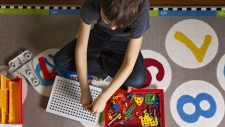 Child playing with toy tool kit. (Shutterstock)