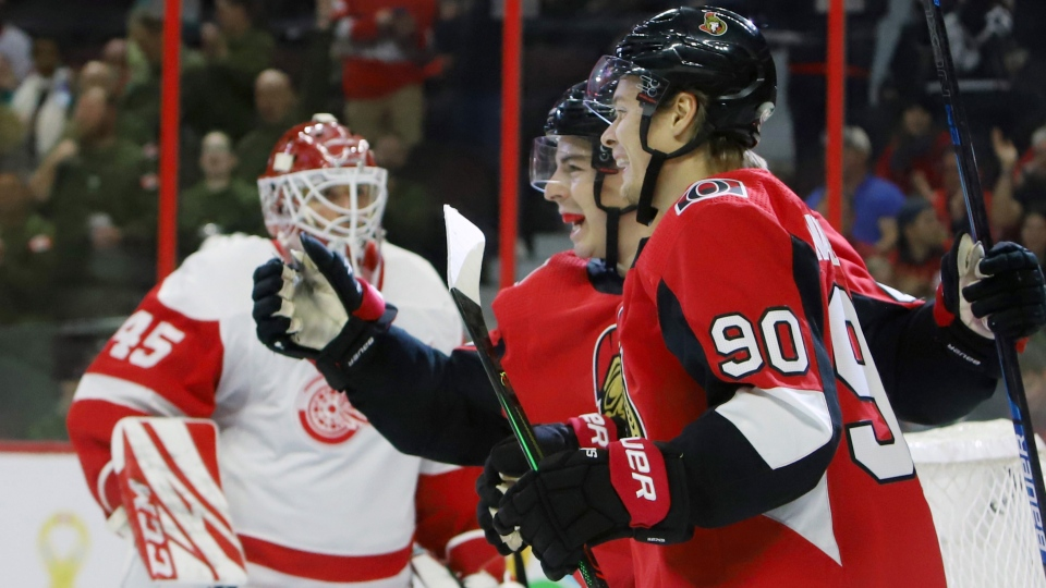 Ottawa Senators centre Jean-Gabriel Pageau (44) celebrates his goal with teammate Vladislav Namestnikov (90) as Detroit Red Wing goaltender Jonathan Bernier (45) looks on during second period NHL hockey action in Ottawa, Wednesday, October 23, 2019. (Fred Chartrand/THE CANADIAN PRESS)
