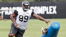 Jacksonville Jaguars defensive tackle Marcell Dareus performs a drill during an NFL football practice Thursday, June 14, 2018, in Jacksonville, Fla. (AP / John Raoux)
