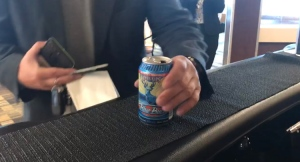A BC Ferries passenger buys a can of beer on the first day of alcohol sales on the South Coast.