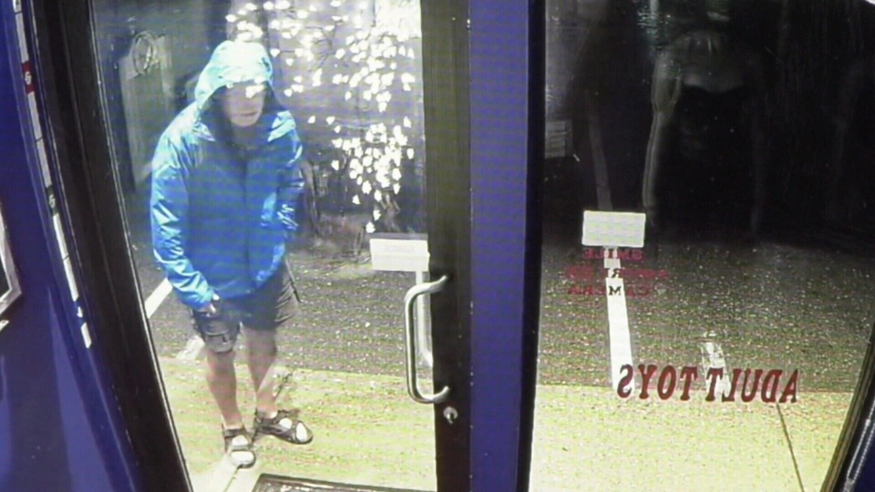 A senior wearing shorts and sandals is seen on surveillance video kicking in the door of the Sexy Kitten Boutique on Oct. 17, 2019. (CTV Vancouver Island)