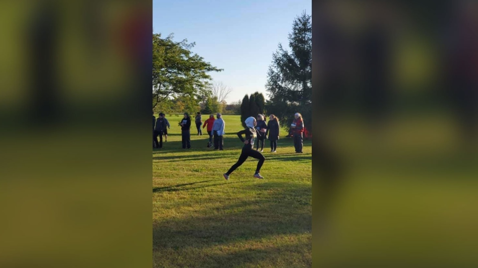 Noor Alexandria Abukaram wears a hijab made for running. She was disqualified for wearing it. (Zobaida S. Falah/Facebook/CNN)