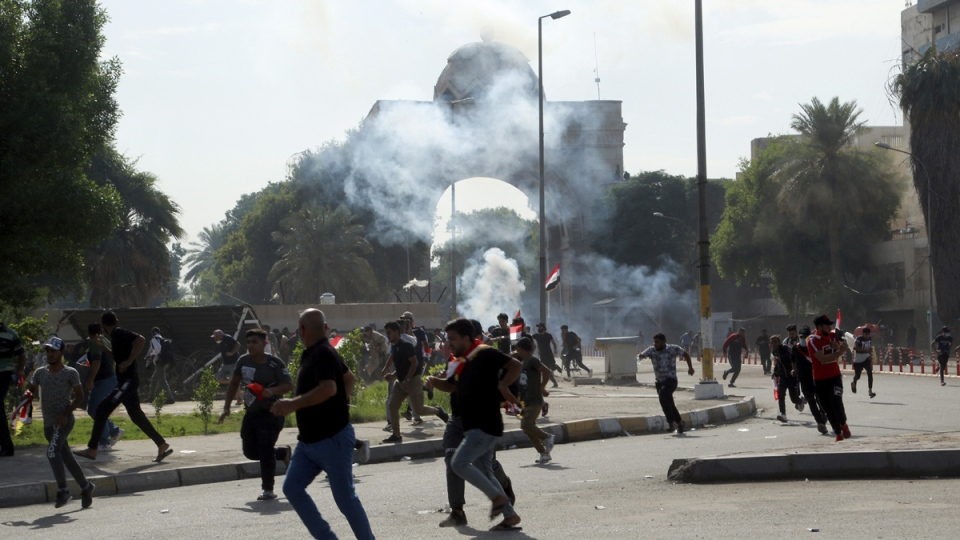 Iraqi security forces fire tear gas in Baghdad