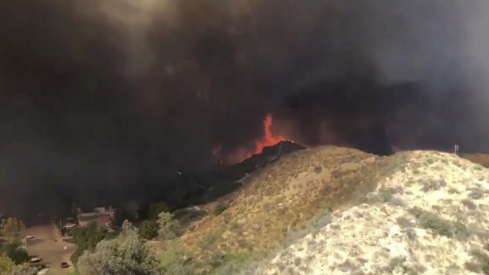 Battling a wildfire in Santa Clarita, Calif.