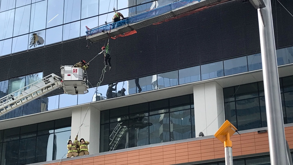 A window washer is rescued from a downtown Edmonton skyscraper. (Brandon Lynch/CTV News Edmonton)