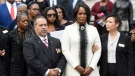 Maya Rockeymoore Cummings, second from right, watches pallbearers move the casket of her husband, Rep. Elijah Cummings, at the conclusion of his funeral service at New Psalmist Baptist Church, Friday, Oct. 25, 2019, in Baltimore. (AP Photo/Steve Ruark)