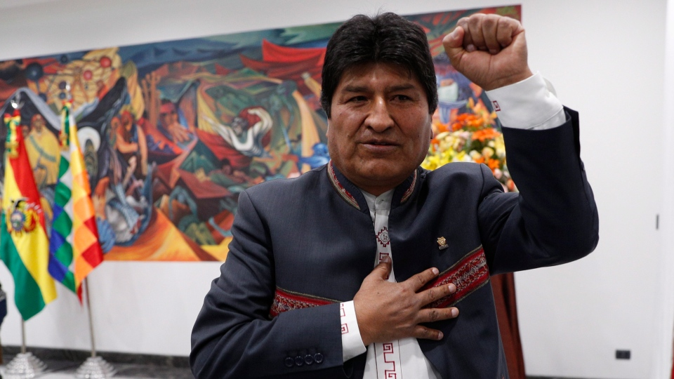 Bolivia's President Evo Morales leaves after a press conference in La Paz, Bolivia, Thursday, Oct. 24, 2019. Morales declared himself the winner of the country's presidential election, saying he received the 10 percentage point lead over his nearest rival needed to win in the first round of voting. (AP Photo/Juan Karita)