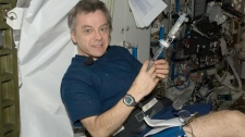 Canadian Space Agency Astronaut Bob Thirsk conducts a test on board the International Space Station on Aug. 4, 2009. Thirsk arrived on the space station in May and is currently in the middle of a six-moth assignment on the space station. (NASA)