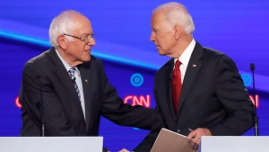 Democratic presidential candidate Sen. Bernie Sanders, I-Vt., left, and former Vice President Joe Biden shake hands following a Democratic presidential primary debate hosted by CNN/New York Times at Otterbein University, Tuesday, Oct. 15, 2019, in Westerville, Ohio. (AP Photo/John Minchillo)