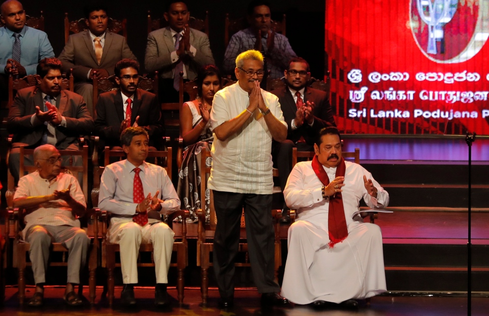Sri Lankan presidential candidate and former defense chief Gotabaya Rajapaksa greets to gathering during the launching of his election manifesto in Colombo, Sri Lanka, Friday, Oct. 25, 2019. (AP Photo/Eranga Jayawardena)