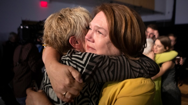 Independent candidate Jane Philpott is hugged by a supporter following her concession speech after losing her Markham-Stouffville seat to Liberal candidate Helena Jaczek in the 2019 Federal Election, on Monday, Oct. 21, 2019. THE CANADIAN PRESS/Chris Young