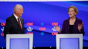 Democratic presidential candidate former Vice President Joe Biden, left, and Sen. Elizabeth Warren, D-Mass., participate in a Democratic presidential primary debate hosted by CNN/New York Times at Otterbein University, Tuesday, Oct. 15, 2019, in Westerville, Ohio. (AP Photo/John Minchillo)