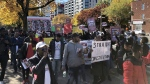 Over 100 members of the Guinean-Canadian community came together to protest a bid by the West African country's leader to seek a third presidential term, in Montreal, Saturday, Oct. 25, 2019. THE CANADIAN PRESS/Christopher Reynolds