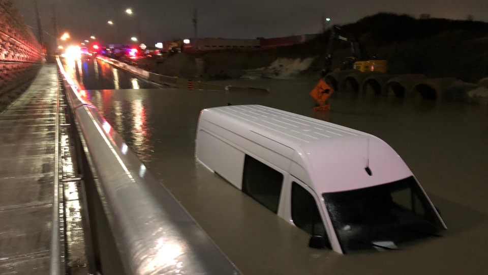 A utility truck is seen underwater after flooding in Brampton Saturday night.