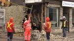 A car hit two hydro poles, a building and a home at Wilson Avenue and Blackfriars Street in London, Ont. on Sunday, Oct. 27, 2019. (Brent Lale / CTV London)
