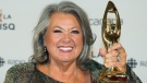 Ginette Reno holds up her award at the Gala Adisq awards ceremony in Montreal, Sunday, October 27, 2019.THE CANADIAN PRESS/Graham Hughes