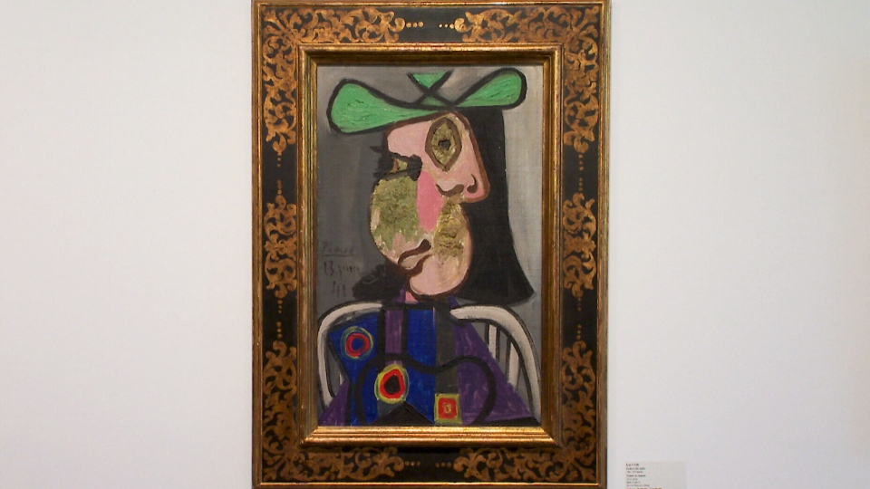 "Picasso's ""Femme au chapeau"" is seen in this image."