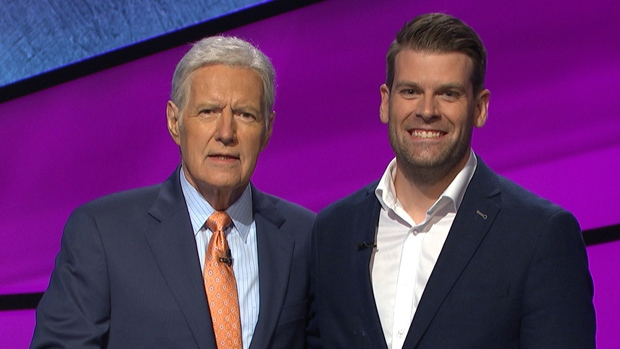 Andrew Thomson with Alex Trebek on Jeopardy