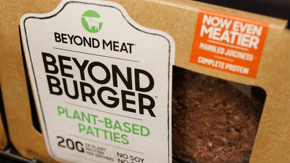 In this June 27, 2019, file photo a meatless burger patty called Beyond Burger made by Beyond Meat is displayed at a grocery store in Richmond, Va. Beyond Meat reports financial earns Monday, Oct. 28. (AP Photo/Steve Helber, File)