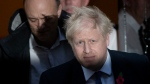 British Prime Minister Boris Johnson and his advisor Dominic Cummings, left, leave 10 Downing Street in London, and get in a car together to go to the Houses of Parliament, Monday, Oct. 28, 2019.  (AP Photo/Matt Dunham)