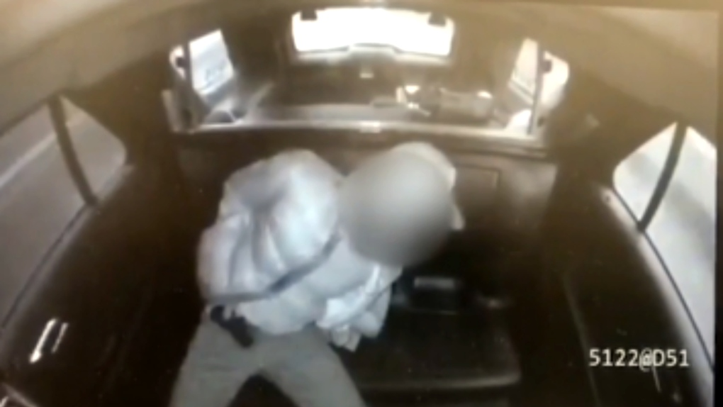 Video appears to show man pull gun out of pants in back of Toronto cruiser