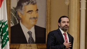 Lebanese Prime Minister Saad Hariri speaks during an address to the nation in Beirut, Lebanon, Tuesday, Oct. 29, 2019. (AP Photo/Hassan Ammar)