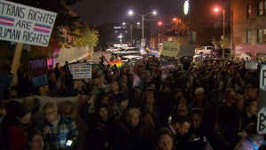 Hundreds of protesters gathered outside of a Toronto library on Tuesday, Oct. 29, 2019 to protest an event by an anti-trans writer and speaker.