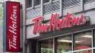 A Tim Horton logo is pictured in Montreal on June 21, 2016. THE CANADIAN PRESS/Paul Chiasson