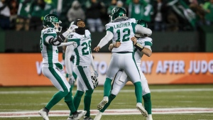 Saskatchewan Roughriders celebrate the win over the Edmonton Eskimos during CFL action in Edmonton, Alta., on Saturday October 26, 2019. THE CANADIAN PRESS/Jason Franson.
