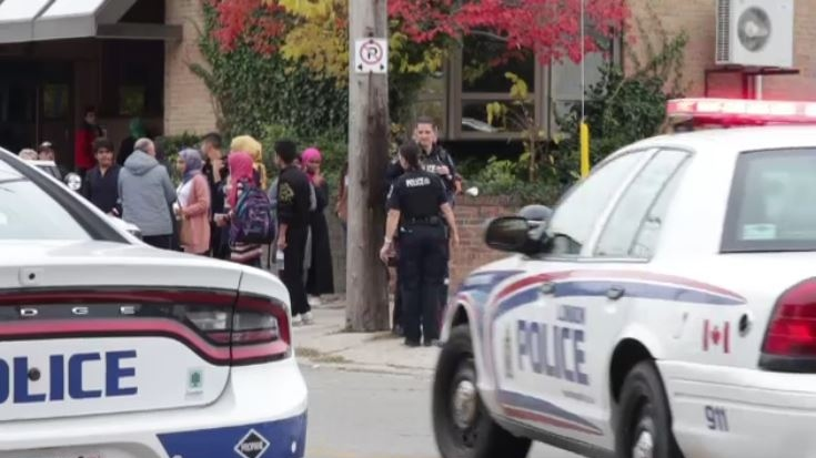 Police are visible at the scene after a brawl in London, Ont. on Tuesday, Oct. 29, 2019. (Marek Sutherland / CTV London)