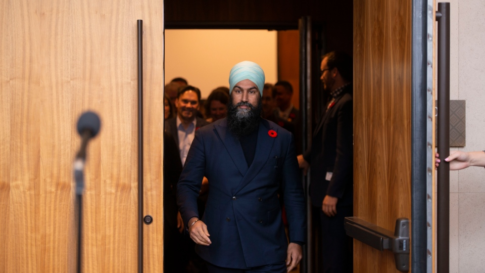 NDP leader Jagmeet Singh makes his way to speak at a press conference following a meeting with his caucus in Ottawa on Wednesday Oct. 30, 2019. THE CANADIAN PRESS/Sean Kilpatrick