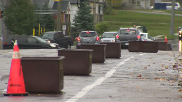 Flower boxes being tested as a solution to separate bike lanes from drivers.